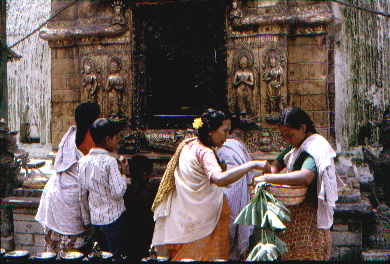 Women making offerings at the template