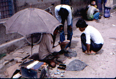 Cobbler working at road side