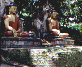Statues of buddhist monks at the entrance to the temple