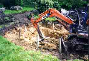 Using the mini digger to dig the main section of the pond