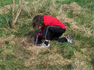 Louise burying Andy's ashes